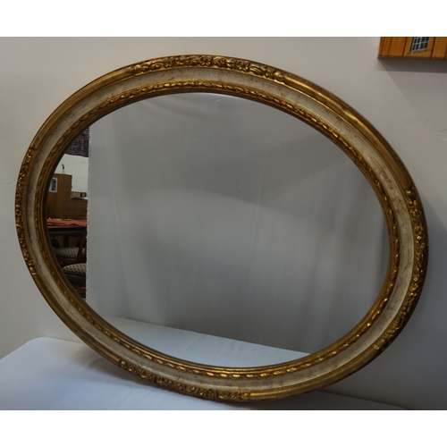 407 - OVAL WALL MIRROR  the gilt frame with carved floral decoration, 91cm wide; together with an oblong w...