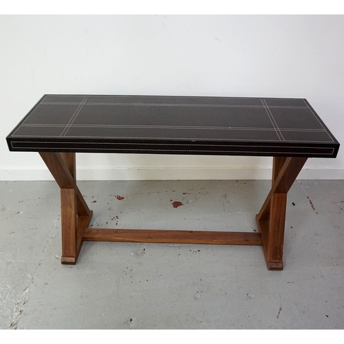 414 - LEATHER TOP SIDE TABLE with decorative geometric stitching, standing on X frame supports, 125cm wide...