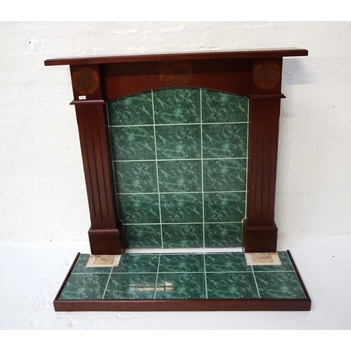 417 - HAND MADE MAHOGANY FIRE SURROUND  with a moulded shelf above an arched frieze carved with a Whooper ...