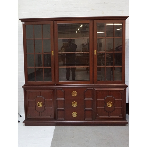 418 - LARGE CHINESE TEAK BOOKCASE  the upper section with three glazed doors and shelved interior, above t...