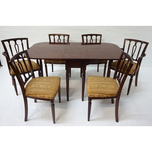 421 - MAHOGANY DINING ROOM SUITE   comprising a crossbanded drop flap table with shaped flaps, standing on...