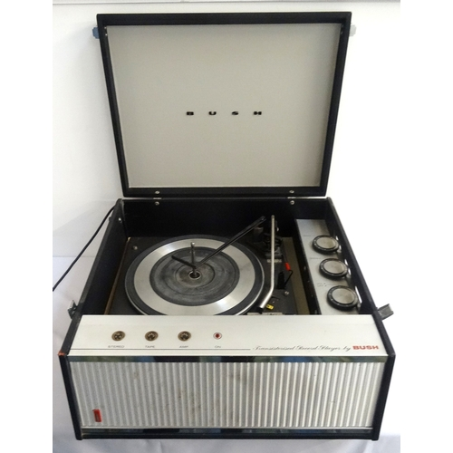 294 - BUSH RECORD PLAYER with lift up lid revealing deck and volume controls, with integrated speaker to f...