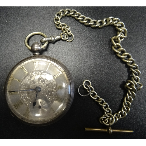 32 - VICTORIAN SILVER POCKET WATCH the silvered dial with engraved floral decoration, Roman numerals, and...