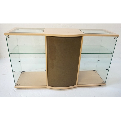 391 - PALE OAK EFFECT DISPLAY CABINET with a shaped top with two inset glass panel sections above a centra...
