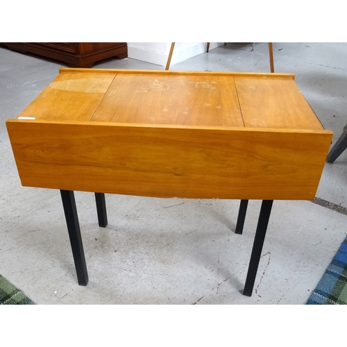 382 - VINTAGE TEAK SEWING TABLE of oblong form with opposing end section drawers, standing on square block...