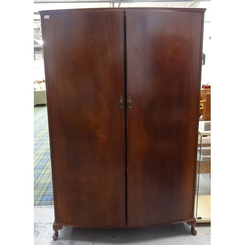 433 - BEITHCRAFT MAHOGANY BOW FRONT WARDROBE with a moulded top above above two doors opening to reveal a ...