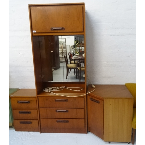 440 - SAKOL TEAK DRESSING CUPBOARD with a moulded square top above a lift up cupboard door, with a pair of...