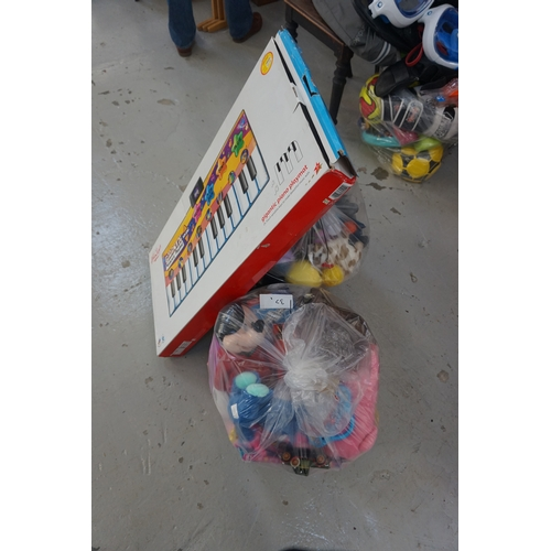37 - TWO BAGS OF TOYS AND GAMES including: HAMLEYS GIGANTIC KEYBOARD PLAYMAT; SOFT TOYS; DOLLS; ACTION FI...