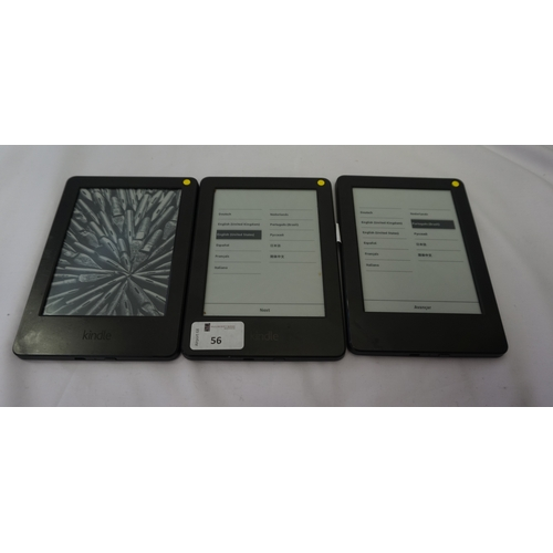 56 - THREE KINDLE BASIC (2014) WIFI DEVICES serial numbers: 90C6 0706 5164 046X; 90C6 0706 5095 08X0 & 90...