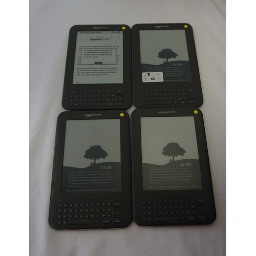 65 - FOUR KINDLE 3 DEVICES comprising: two KINDLE 3 WIFI & 3G, serial numbers: B00A D0B1 1305 0CED & B00A...