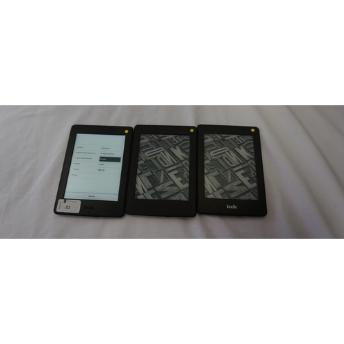 71 - THREE KINDLE PAPERWHITE DEVICES comprising: two KINDLE PAPERWHITE 3 (2015) WIFI, serial numbers: G09...
