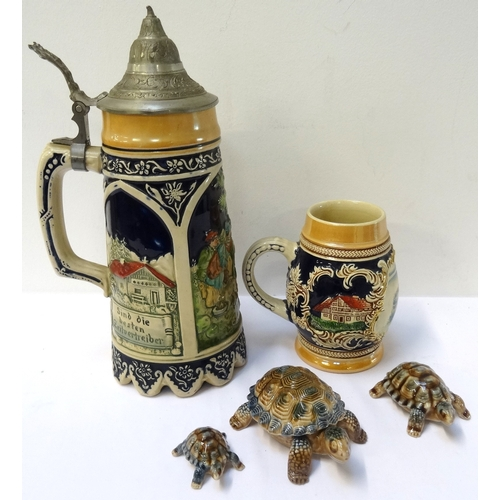 154 - THREE GRADUATED WADE TORTOISES decorated in brown and blue, a musical stein with a pewter lid, the b...