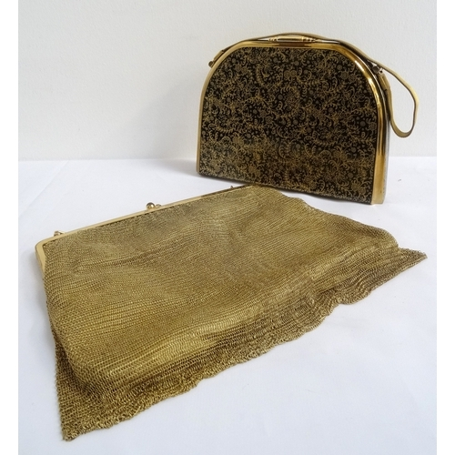 252 - 1950s HARD SHELL EVENING BAG BY STRATTON with floral gilt decoration on a black ground, opening to r...