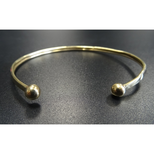 3 - NINE CARAT GOLD BANGLE with ball finials, approximately 2.4 grams...