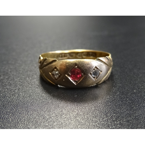 4 - EDWARDIAN GYPSY STYLE RUBY AND DIAMOND RING the central ruby flanked by diamonds, in fifteen carat g...