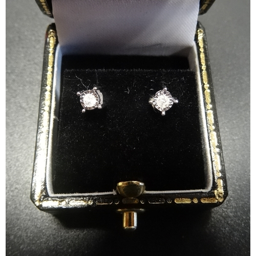 15 - PAIR OF DIAMOND STUD EARRINGS the illusion set diamonds totalling approximately 0.1cts, in nine cara...