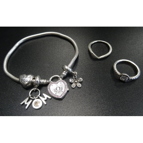 24 - PANDORA MOMENTS SILVER LOCK YOUR PROMISE HEART CLASP BRACELET with three Pandora charms; together wi...