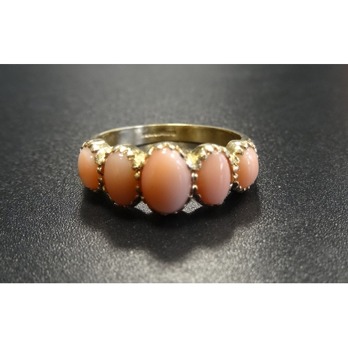 26 - GRADUATED CORAL FIVE STONE RING on nine carat gold shank, ring size N...