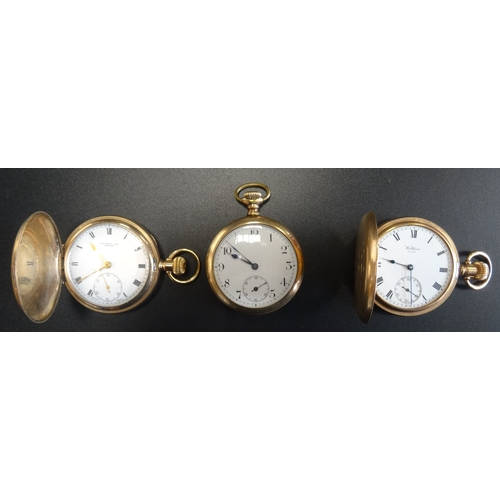 29 - THREE GOLD PLATED POCKET WATCHES all with top winders, comprising two hunters with black Roman numer...