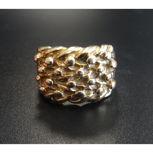 31 - HEAVY NINE CARAT GOLD DRESS RING with textured decoration, ring size Y and approximately 17.1 grams