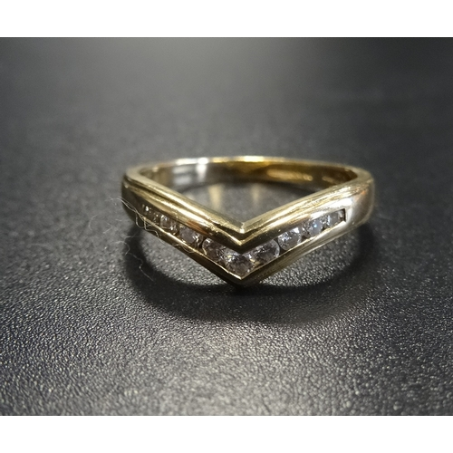 32 - CHANNEL SET DIAMOND WISHBONE DESIGN RING the diamonds totalling approximately 0.2cts, in nine carat ...