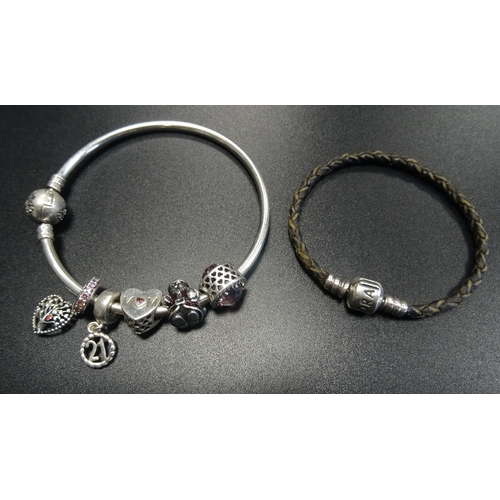 39 - SELECTION OF PANDORA JEWELLERY comprising a Moments silver bangle with five charms; together with a ...