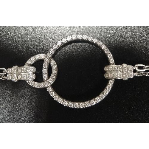 40 - LADIES PIAGET DIAMOND SET EIGHTEEN CARAT WHITE GOLD BRACELET the seventy-nine brilliant cut diamonds...