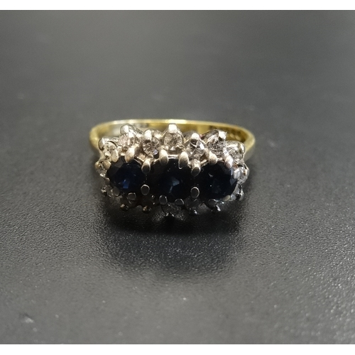 42 - SAPPHIRE AND DIAMOND CLUSTER DRESS RING the three central sapphires in multi diamond surround, on ei...