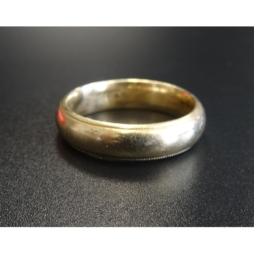 43 - FOURTEEN CARAT GOLD WEDDING BAND ring size V and approximately 9.1 grams...