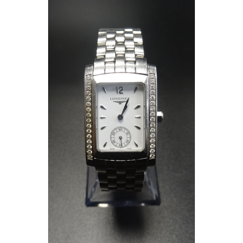 47 - LADIES LONGINES DOLCE VITA DIAMOND SET WRISTWATCH the white dial with subsidiary seconds dial flanke...