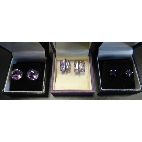 49 - THREE PAIRS OF SILVER EARRINGS comprising two pairs of round cut Amethyst stud earrings of graduated...