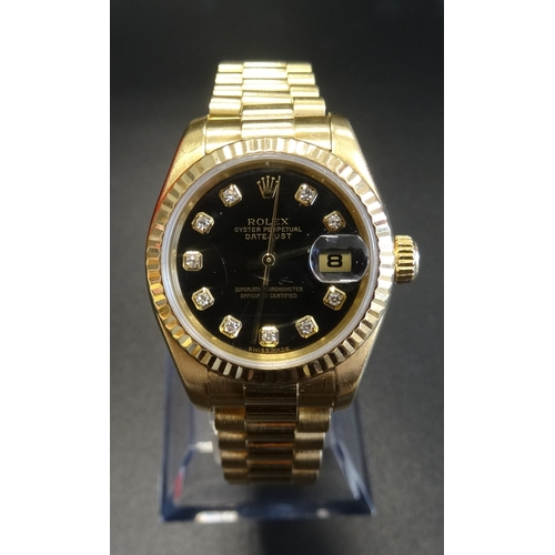 50 - LADY'S EIGHTEEN CARAT GOLD CASED ROLEX OYSTER PERPETUAL DATEJUST WRISTWATCH the black dial set with ...