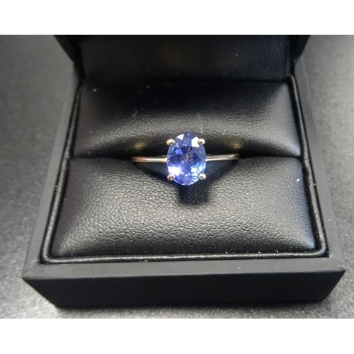 58 - TANZANITE SOLITAIRE RING the oval cut tanzanite approximately 1ct, on eighteen carat gold shank, rin...