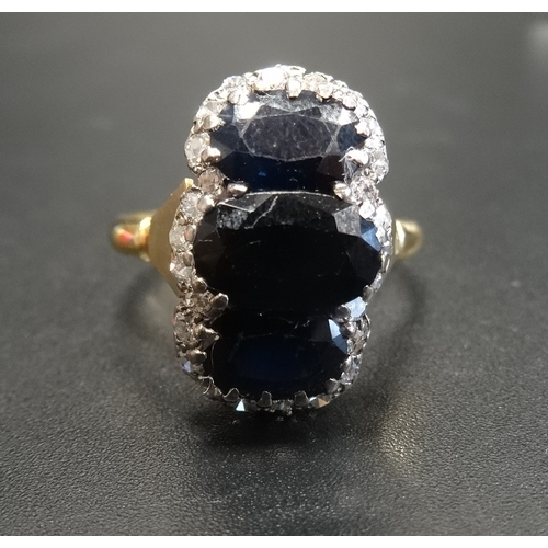 60 - SAPPHIRE AND DIAMOND CLUSTER DRESS RING the central three oval cut sapphires in unusual vertical set...