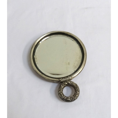 142 - VICTORIAN STERLING SILVER BACKED CIRCULAR DRESSING MIRROR with profuse embossed floral and foliate d...