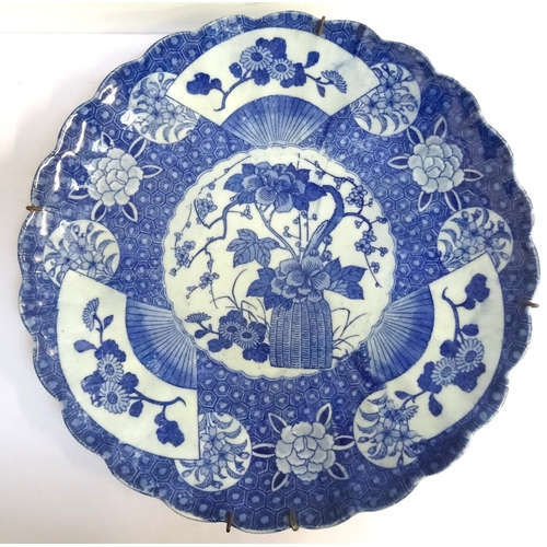 150 - JAPANESE PORCELAIN WALL CHARGER early 20th century, with ribbed body and frilly border, the central ...