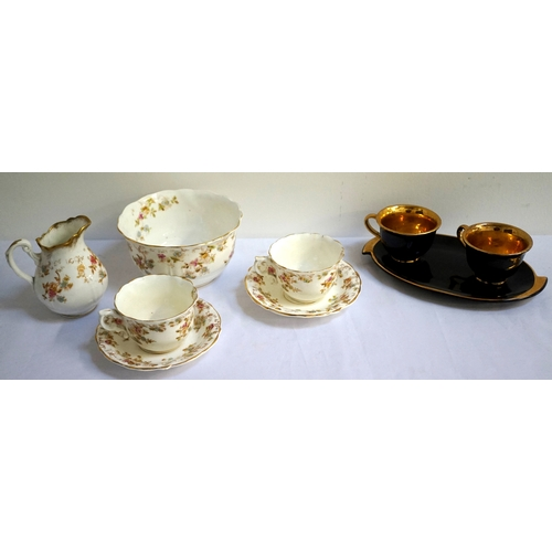173 - FLORAL DECORATED TEA SERVICE with gilt border comprising six cups and saucers, five side plates, a s...