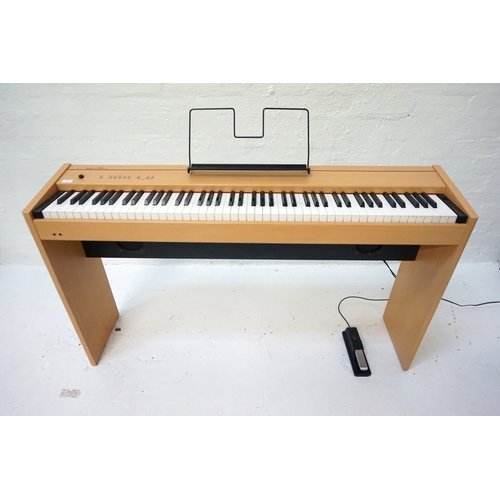 242 - ROLAND F-90 DIGITAL PIANO in a maple style case with an eight eight note digital piano hammer action...