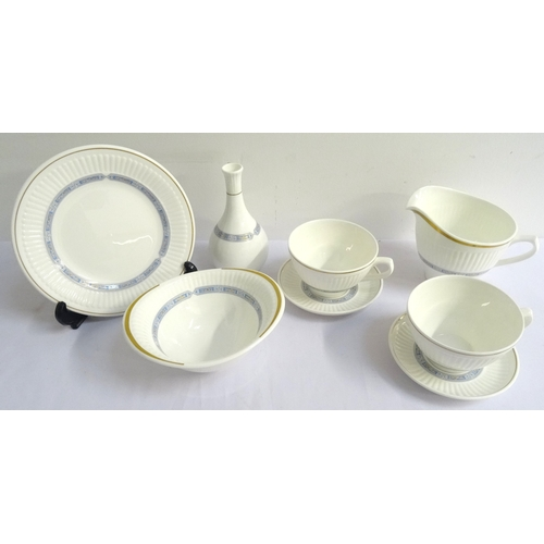 160 - WEDGWOOD INSIGNIA PATTERN DINNER SERVICE comprising dinner and side plates, soup bowls and saucers, ...