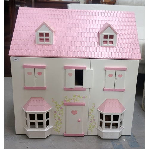259 - CHILD'S DOLLS HOUSE of wooden and plastic construction with an opening double front revealing two fl...