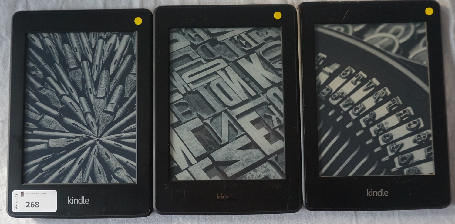 THREE KINDLE PAPERWHITE DEVICES comprising: one KINDLE PAPERWHITE 3