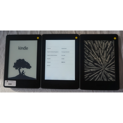 THREE KINDLE PAPERWHITE 3 (2015) DEVICES serial numbers: G090 G505