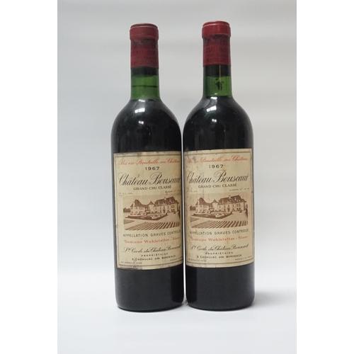 30 - CHATEAU BOUSCAUT 1967 VINTAGE A pair of vintage bottles of Bordeaux.  Chateau Bouscaut 1967 Vintage....