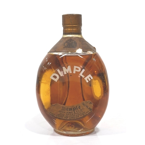 37 - HAIG'S DIMPLE 1960s A bottle of Haig's Dimple Blended Scotch Whisky from the 1960s.  26 2/3 Fl. ozs....