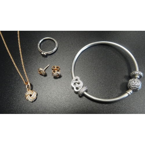 3 - SELECTION OF PANDORA JEWELLERY comprising a Pandora Rose Sparkling Love Knot pendant on chain with m...