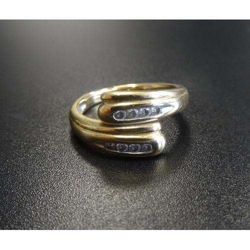 16 - CHANNEL SET DIAMOND TWIST DESIGN RING in eighteen carat gold, ring size M...