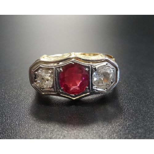 18 - SYNTHETIC RUBY AND DIAMOND THREE STONE RING the central round cut ruby approximately 1ct flanked by ...