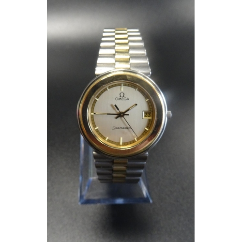20 - GENTLEMAN'S OMEGA SEAMASTER WRISTWATCH with a circular gold coloured dial with baton hour markers, d...