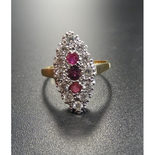 22 - RUBY AND DIAMOND CLUSTER RING  the three vertically set rubies in diamond surround, the diamonds tot...