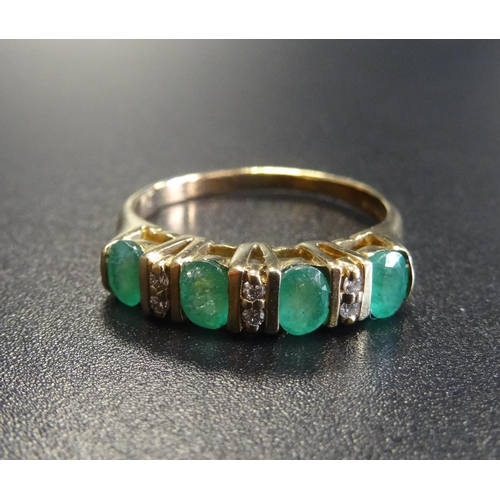 23 - EMERALD AND DIAMOND RING the four oval cut emeralds separated by small diamonds, on nine carat gold ...